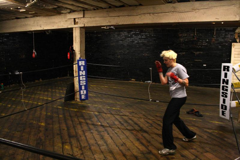 Maira Madrigal shadow boxes at the One Punch Boxing club gym, an old apple warehouse near Wenatchee.