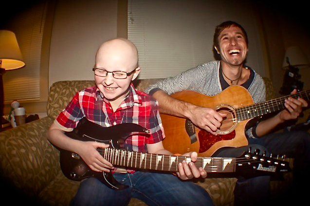 Braydon Hutchison, 11, and Melodic Caring Project founder Levi Ware jam at the Ronald McDonald House in Seattle.
