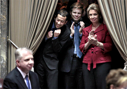 Gov. Chris Gregoire, right, applauds with Rep. Jaimie Pedersen, second right, and Michael Shiosaka, partner of Rep. Ed Murray, left, after a Washington state Senate vote to legalize same-sex marriage Wednesday evening.