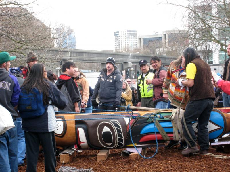 Roughly 90 people carried a totem honoring slain First Nations woodcarver John T. Williams from the Seattle Waterfront to Seattle Center on Sunday.