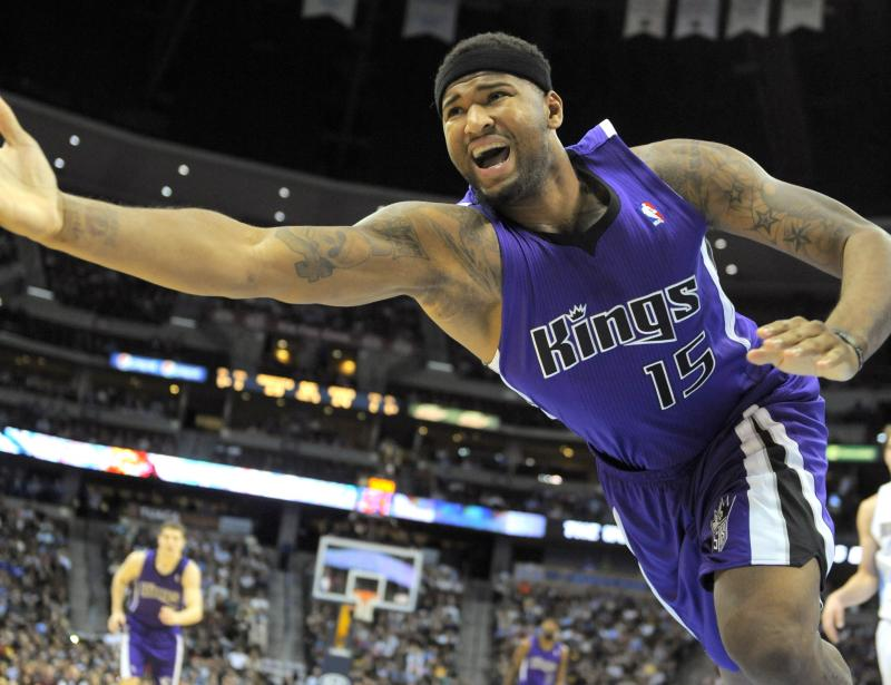 Lunging toward Seattle? Sacramento Kings forward DeMarcus Cousins dives to save the ball in a game on Wednesday.
