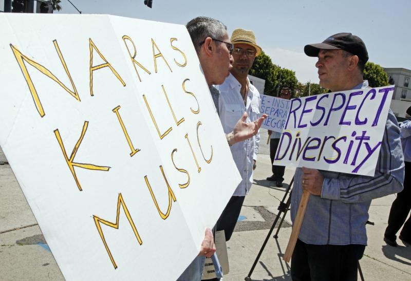 Oscar Hernandez, right, two-time Grammy winner for Latin Jazz Album, joins musicians and others demonstrating outside a meeting of the board of the National Academy of Recording Arts and Sciences (NARAS) in May.