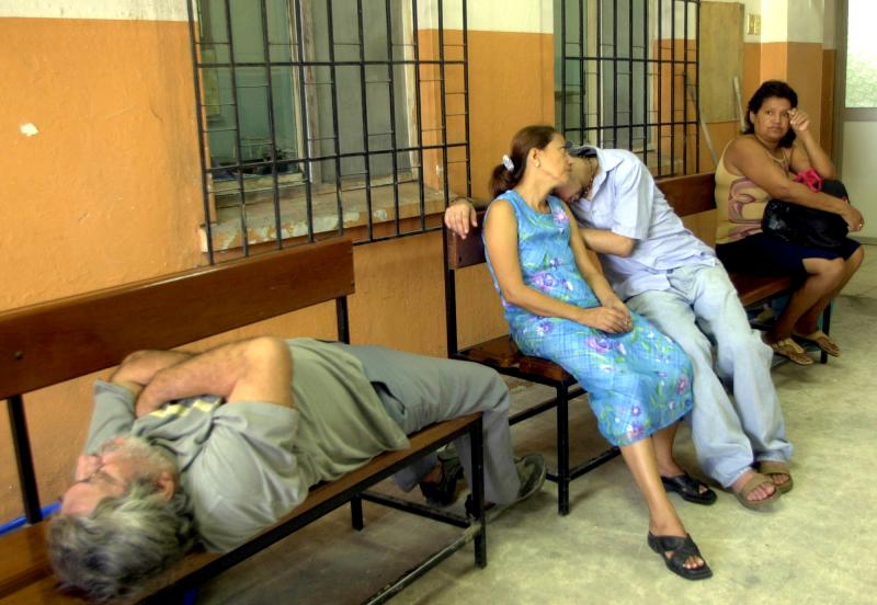 In this 2003 file photo, patients wait to hear the results of their tests for Malaria, at a hospital in Guayaquil, Ecuador. Malaria may be killing about twice as many people as experts previously thought, new research suggests.