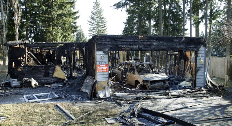 The charred rubble of the home where Josh Powell and his two sons were killed Sunday, in Graham, Wash., in what police said appeared to be a deliberately set fire is shown on Tuesday.