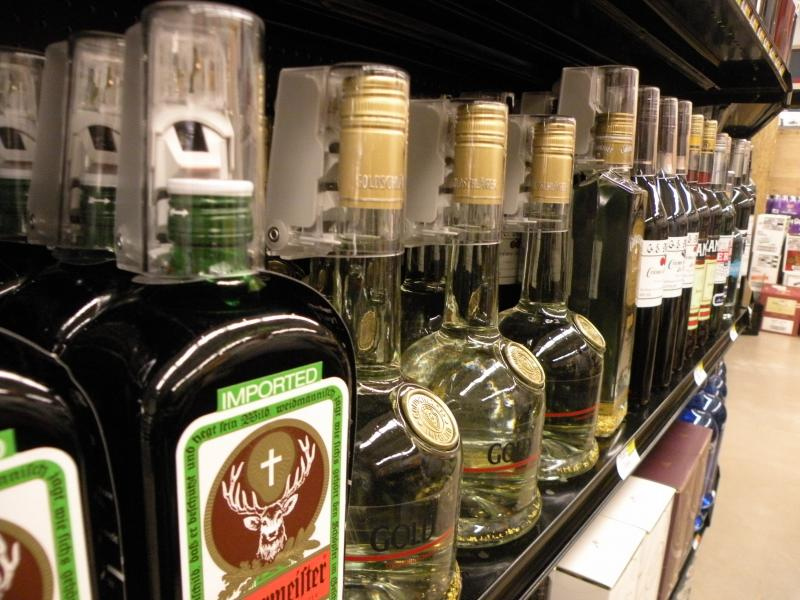 As the liquor privatization law goes into effect, many Washington state supermarkets will add security caps to bottles