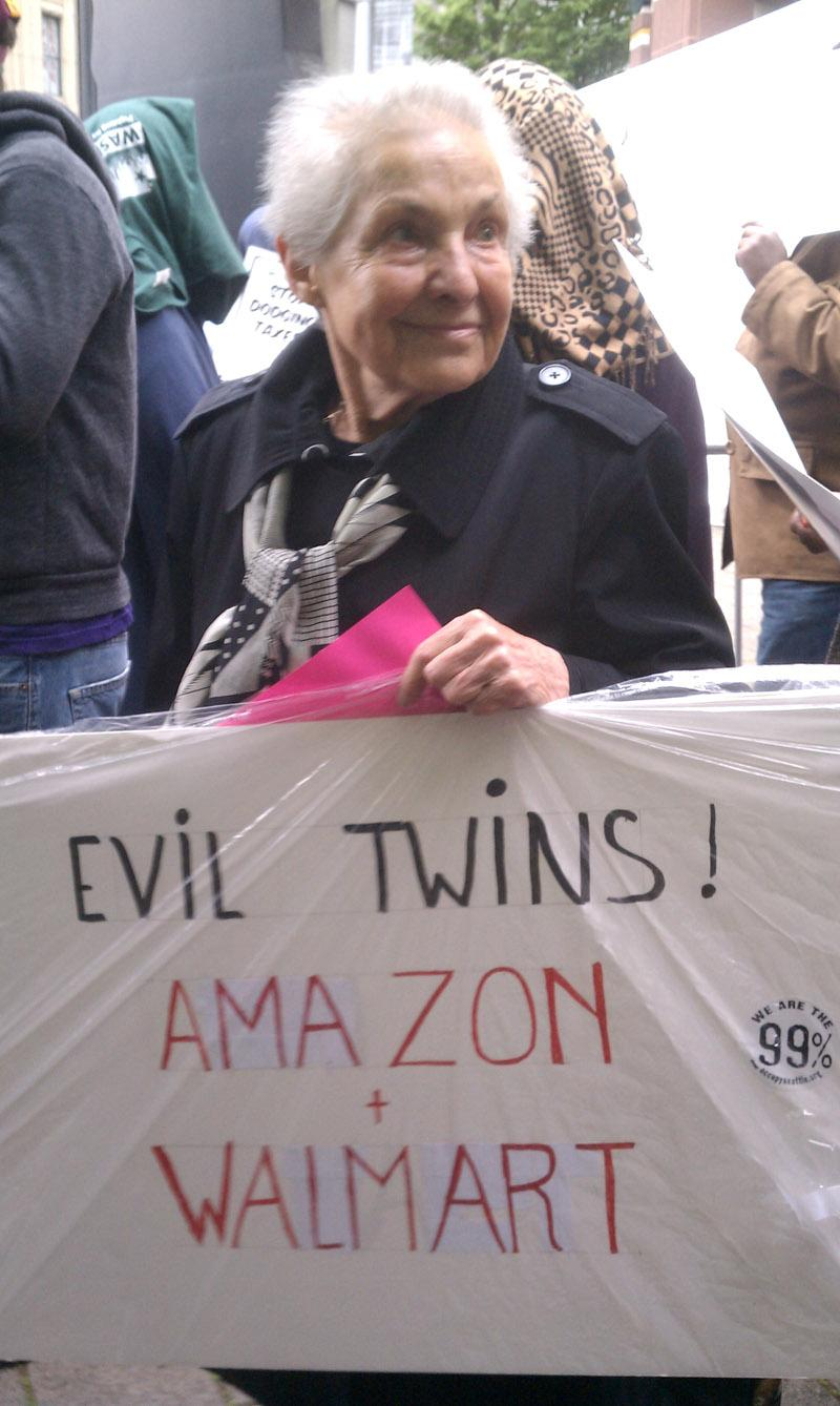 Protester Dorli Rainey showed up at the Seattle Art Museum to let Amazon know what she thought at the company's annual meeting in Seattle on Thursday.