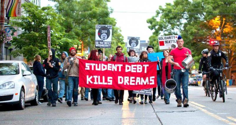 #MicCheckWallStreet activists marching on Broadway on June 13 to protest student loan interest hikes.