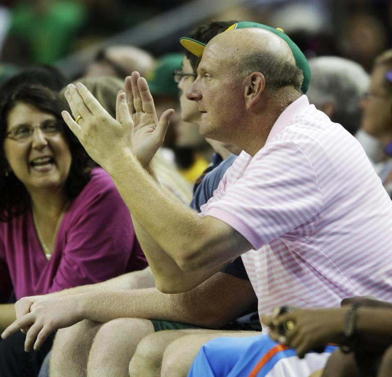 Microsoft CEO Steve Ballmer cheering during a charity basketball game in Seattle last year - he's all in on the new arena.