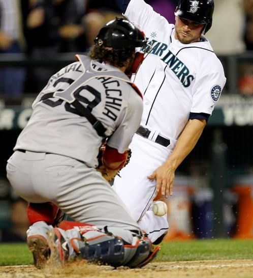Seattle's Casper Wells slides into home to score the winning run last night against Boston. The Mariners won 1-0.