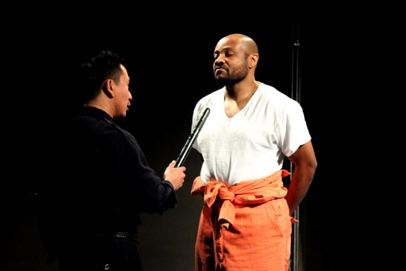 "Ray Tagavilla (l) as a prison guard and Dumi as Lucius Jenkins in Azeotrope's production of ""Jesus Hopped the A Train"" at Seattle's ACT Theatre."