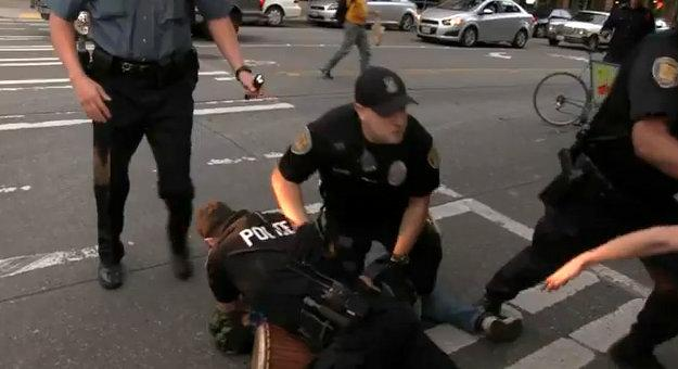 In this screen grab from the video shot by someone with the #MicCheckWallStreet protesters, Seattle police officers make an arrest.
