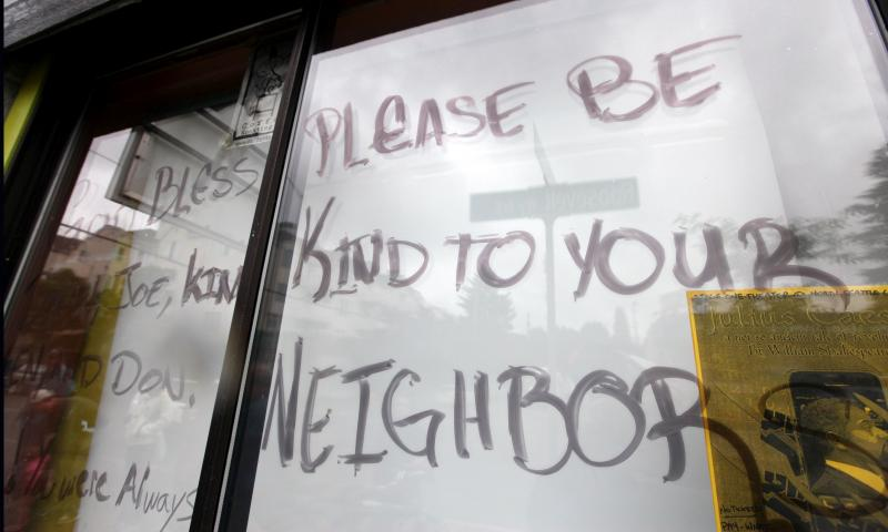 A message is written on paper covering the window at the front of a cafe where a gunman killed four people and severely wounded another last week.