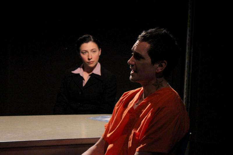 "Richard Nguyen Sloniker as inmate Angel Cruz and Angela DiMarco as his public defender in Azeotrope's production of ""Jesus Hopped the A Train."""