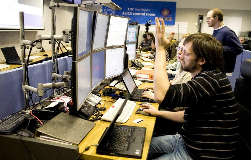 A scientist of the European Organization for Nuclear Research, CERN, gestures in the Alice experiment control room at their headquarters outside Geneva, Switzerland, in 2010. Back then, CERN was downplaying rumors of a discovery.