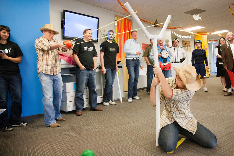 Troy Brockway throws a slingshot in Guidant Financial's office Olympics