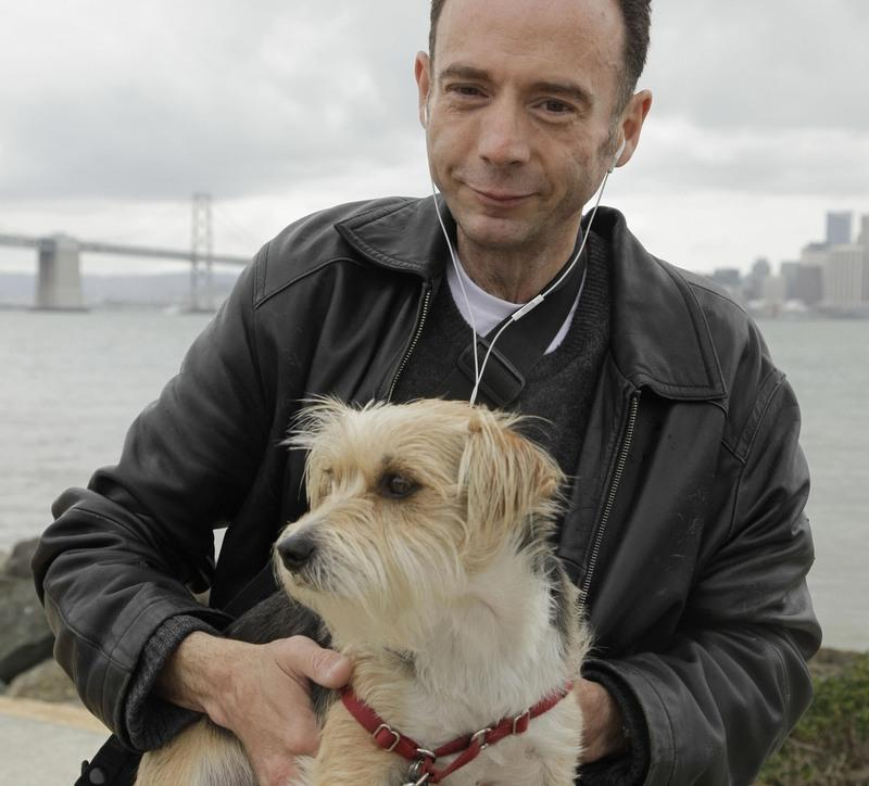 "In this photo taken May 16, 2011, Timothy Brown, the only man ever known to have been cured from AIDS, poses with his dog, Jack, on Treasure Island in San Francisco. Brown has been called ""the Berlin patient"" because that's where he was treated."