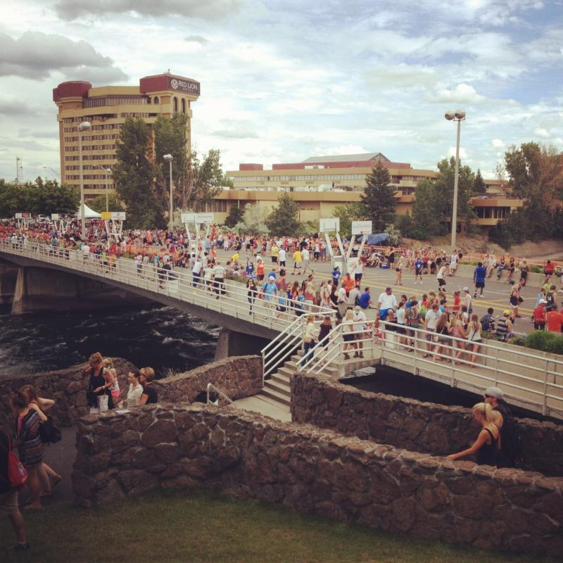 Hoopfest participants playing over the Spokane river.