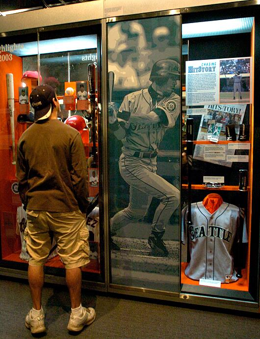 Shawn Redmond, of Camano Island looks at an exhibit featuring items from Seattle Mariners' Ichiro Suzuki's hitting record at the National Baseball Hall of Fame and Museum in Cooperstown, N.Y.on Nov. 8, 2004.