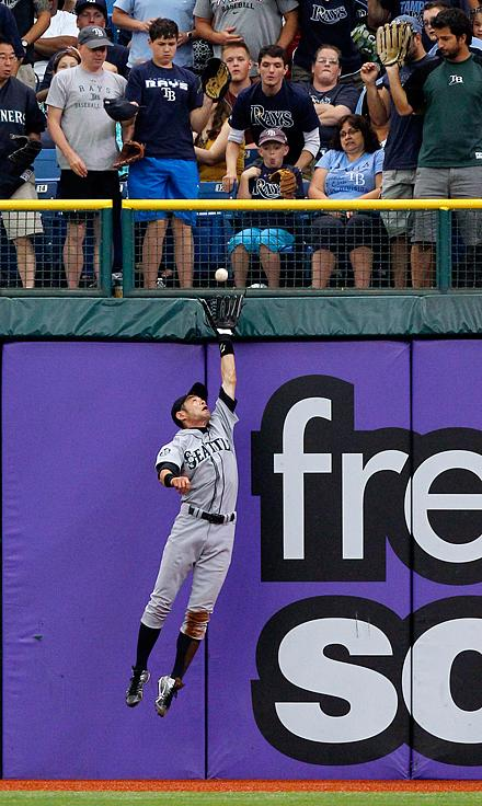 Right fielder Ichiro Suzuki makes a catch on a fly ball by Tampa Bay Rays' Carlos Pena during the first inning of a baseball game, Sunday, July 22, 2012, in St. Petersburg, Fla.