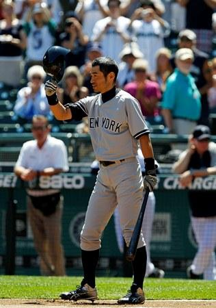Ichiro tips his batting helmet to fans as he steps up to bat against the Mariners in the first inning of Wednesday's game at Safeco Field.