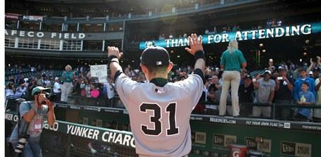Mariner-turned-Yankee Ichiro Suzuki waves to fans as he leaves the field following Wednesday's game against the Mariners at Safeco Field.