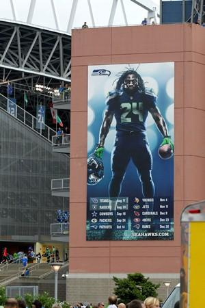 A poster of Seahawks running back Marshawn Lynch greets fans entering CenturyLink Field. The poster also includes the Seahawks 2012 schedule, which could be impacted by Lynch's DUI arrest.