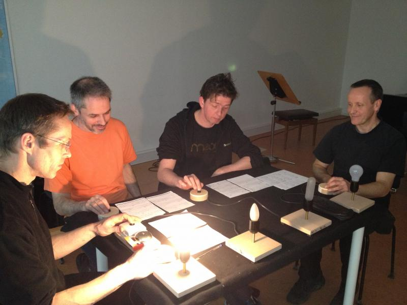 Members of the Schlagquartett Koeln percussion ensemble, rehearsing a piece by John Cage for the Acht Bruecken festival. They play silent light bulbs, buzzers and vintage razors in the piece.