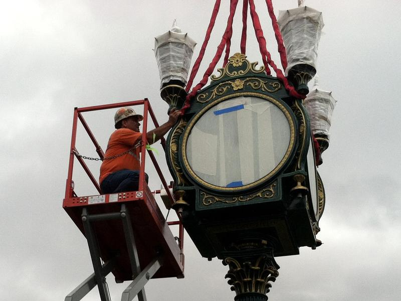 A worker prepares Carroll's Clock for the move.