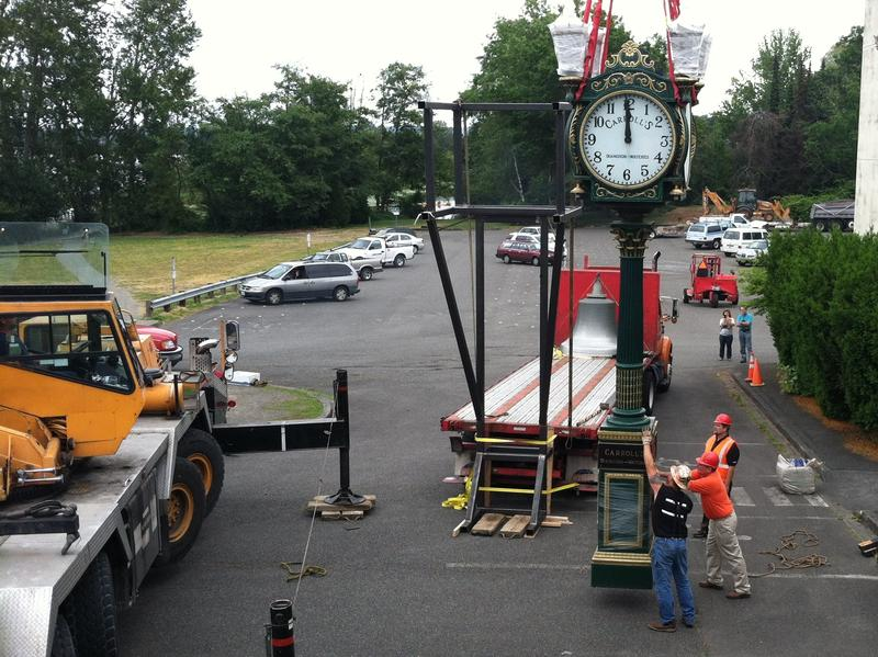 Workers prepare to load Carroll's Clock onto a truck.