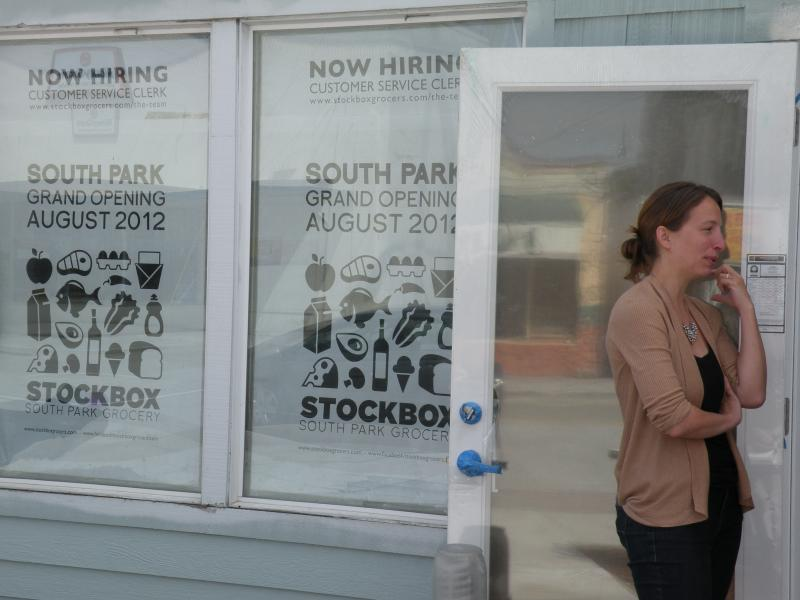 Carrie Ferrence prepares for the grand opening of Stockbox South Park Grocery