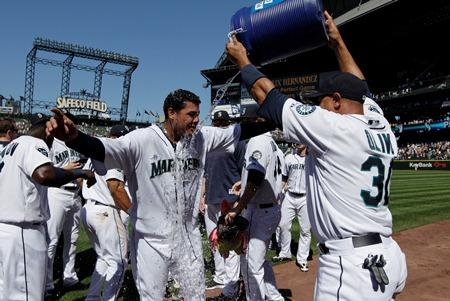 Felix is doused by Miguel Olivo after his perfect game.