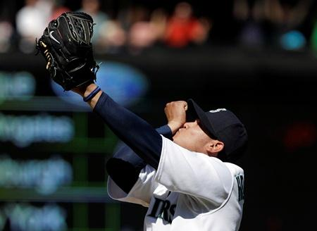 Felix Hernandez kisses his right wrist after throwing a perfect game on Wednesday against the Tampa Bay Rays at Safeco Field. The Mariners won 1-0.
