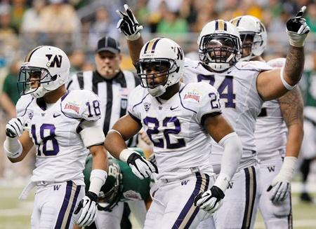 Washington's Josh Shirley, center, Gregory Ducre, left, and Alameda Ta'amu celebrate a sack during the first half of the Alamo Bowl against Baylor Dec. 29, 2011, in San Antonio.