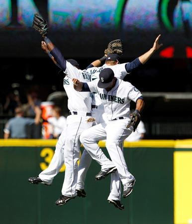Team effort: Mariners outfielders Trayvon Robinson, Eric Thames and Michael Saunders leap together after the team beat the Cleveland Indians 3-1 Wednesday at Safeco Field.