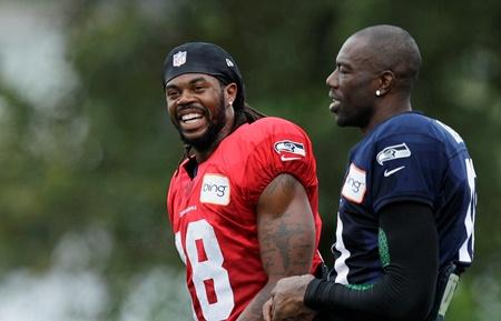 Terrell Owens laughs with fellow Seahawks wide receiver Sydney Rice during training camp Wednesday in Renton. Rice had two shoulder surgeries in the off-season and Art Thiel says Owens will help fill out that position.