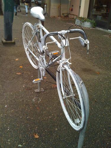 """Ghost cycle"" installations in Seattle indicated where a cyclist has been hit. For more information on the ghost cycles, go to http://ghostbikes.org."