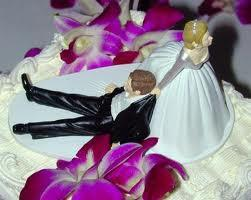 The little man on the wedding cake celebrates to excess..