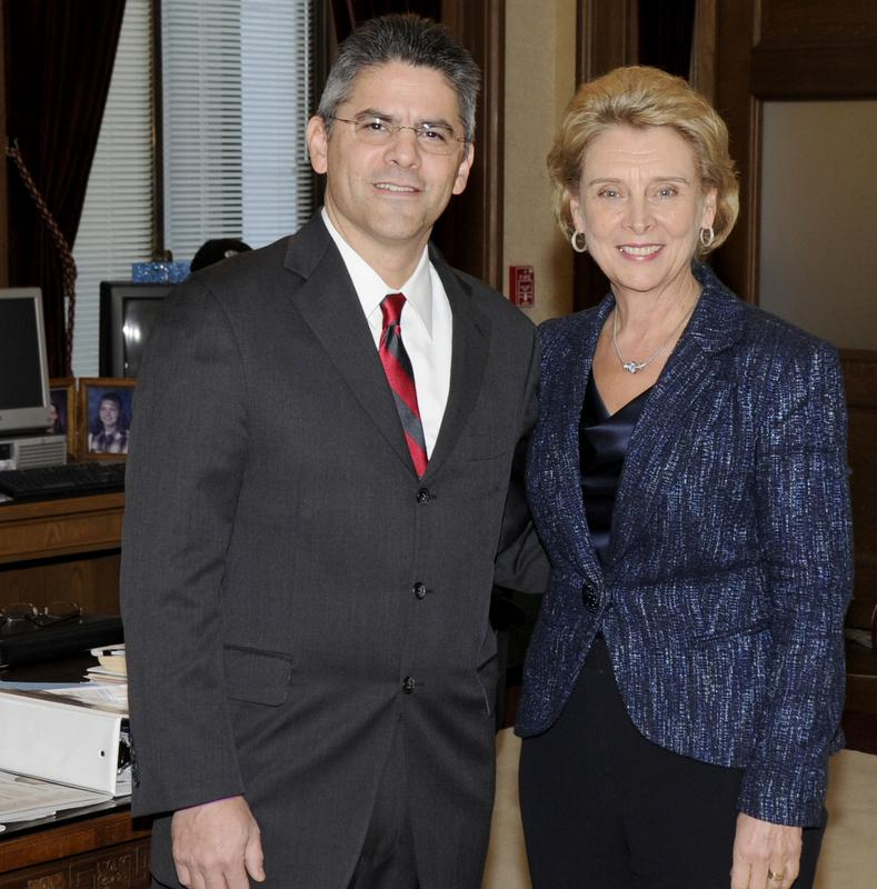 Gov. Chris Gregoire poses for a photo with Steven Gonzalez in 2011 when Gregoire appointed him to the Washington State Supreme Court.