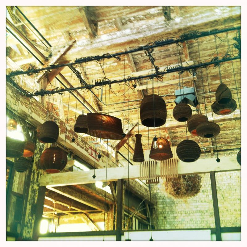 Some of the lampshades and pendants made out of cardboard at the SODO warehouse for Gray Pants