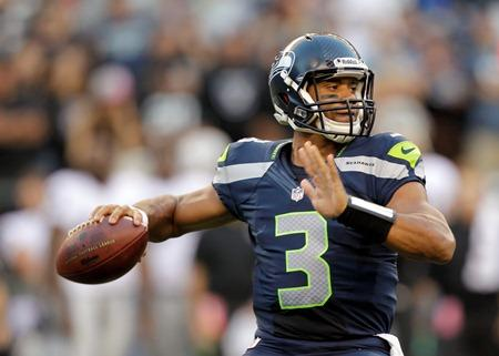 Seahawks rookie quarterback Russell Wilson in action against the Oakland Raiders in a preseason game in Seattle.