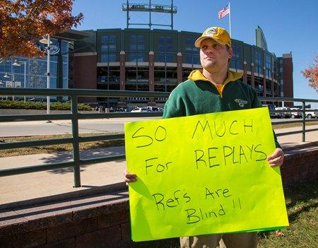 Packers fan Mike LePak holds a sign in front of Lambeau Field in Green Bay on Tuesday, Sept. 25 in protest of the controversial call that gave the Seahawks the win in Monday Night Football.