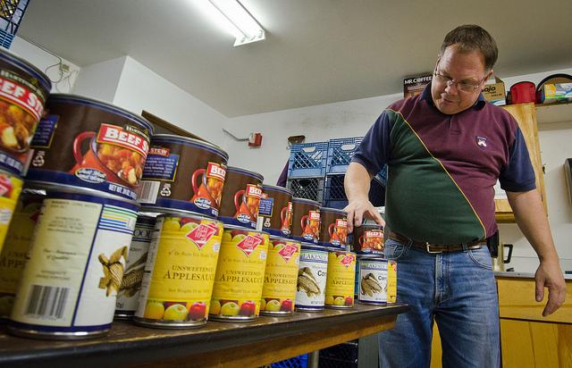 A Tukwila food pantry stocks its tables. Emergency food providers say demand is up since the recession.