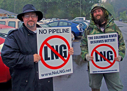 Portland attorney Robert Lorey (left) and Astoria marine biologist Dave Lillis protest natural gas exports outside the Warrenton Community Center.