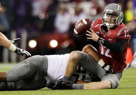 WSU quarterback Connor Halliday is sacked by Oregon's Wade Keliikipi in a game last month.