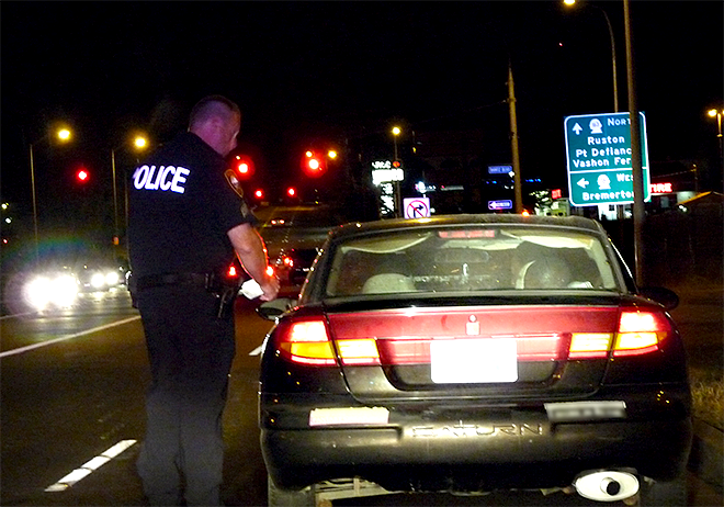 Sgt. Robert Thompson of the Puyallup Police Dept. makes a traffic stop, looking for impaired drivers.