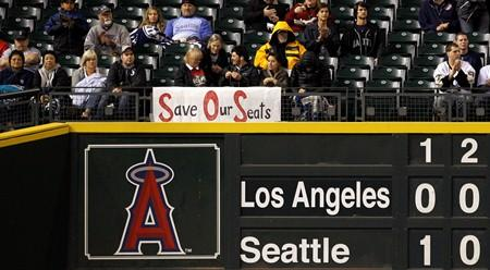 A sign put up by Mariners fans behind left field indicates a concern for their seats. The Mariners this week announced plans to move in the outfield fences at Safeco Field for the 2013 season to make it easier on hitters.