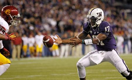 UW quarterback Keith Price reaches for the ball as he fumbles it against Southern California on Oct. 13. USC recovered at its own 4-yard line and won the game 24-14.