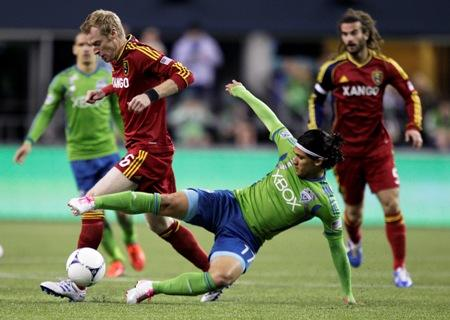 The Sounders' Fredy Montero comes in from the side to challenge Real Salt Lake's Nat Borchers for the ball in their match on Oct. 17, 2012, in Seattle. The teams played to a 0-0 draw.