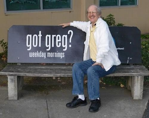 Greg Heberlein sitting on a bench advertising Greg Glover's morning show on KNRK in Portland.
