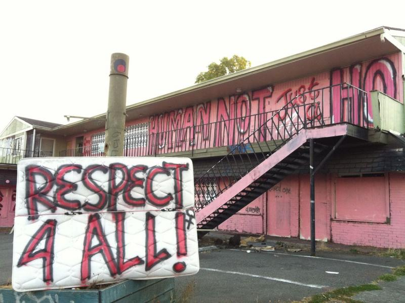 Part of the Grrrl Army's work on the abandoned Thunderbird Motel on Aurora Ave in Seattle.